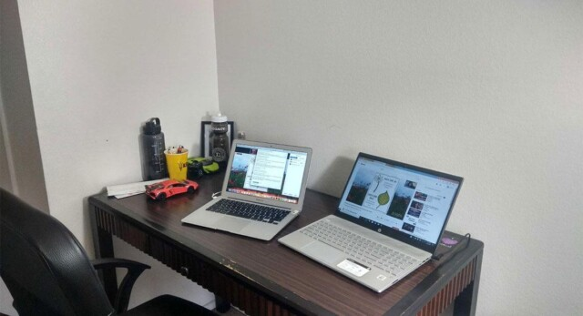 A desk with two laptops