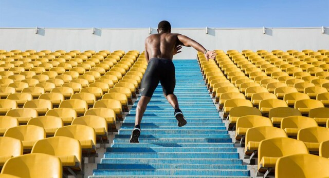 A man running up stairs at a stadium