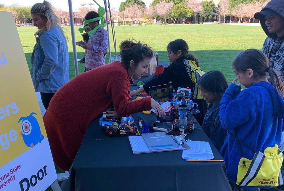 ETC Ashley Goernitz teaches easy programming with the Lego Boost robots at the West Campus event.