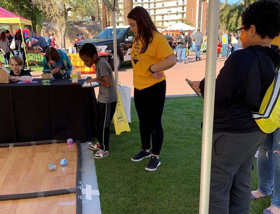 A young visitor at Open Door Tempe learns how to control a Spheros bot.