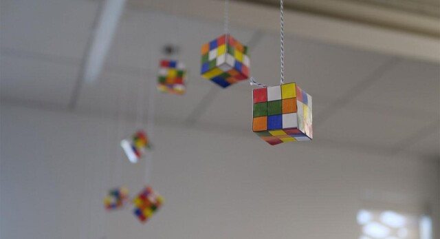 Paper Rubik's cubes hanging from the ceiling