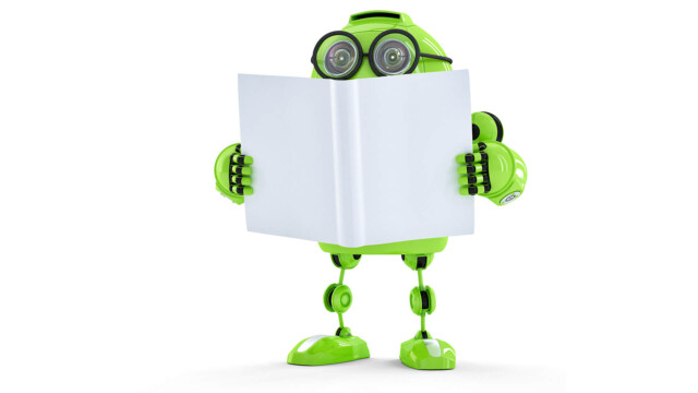 A green robot reading a book